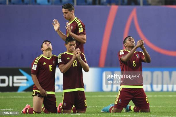 Venezuela's midfielder Ronaldo Lucena defender Ronald Hernandez and midfielder Christian Makoun react during the penalty shootout in the U20 World...