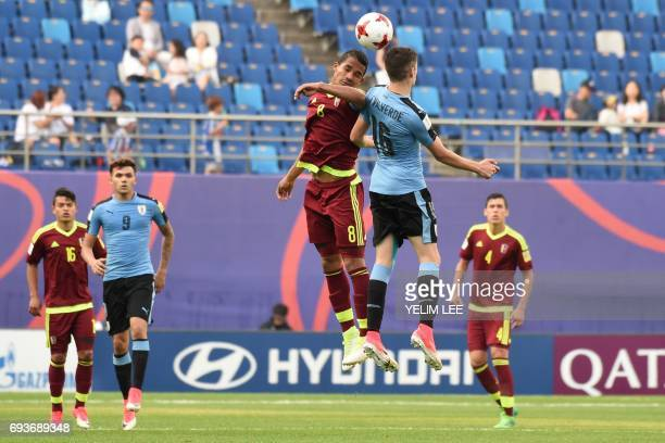 Venezuela's midfielder Yangel Herrera and Uruguay's midfielder Federico Valverde compete for the ball during the U20 World Cup semifinal football...