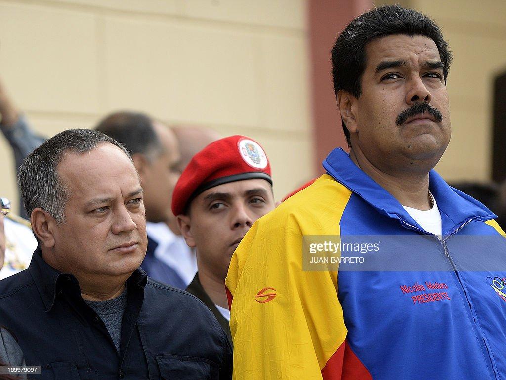 Venezuela's National Assemby President Diosdado Cabello (L) and Venezuelan president Nicolas Maduro (R), attend a ceremony three months after Hugo Chavez's death, at the Cuartel de la Montana in Caracas, on June 05, 2013. AFP PHOTO