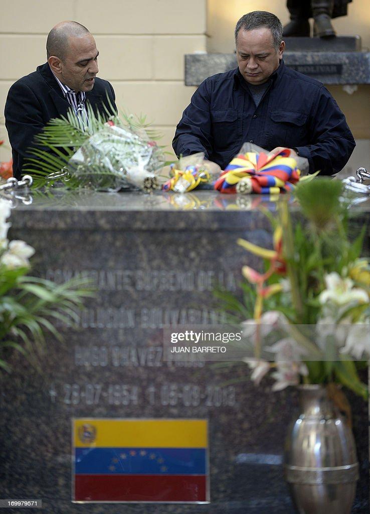 Venezuela's National Assemby President Diosdado Cabello (R) attends a ceremony three months after Hugo Chavez's death, at the Cuartel de la Montana in Caracas, on June 5, 2013. AFP PHOTO/JUAN BARRETO