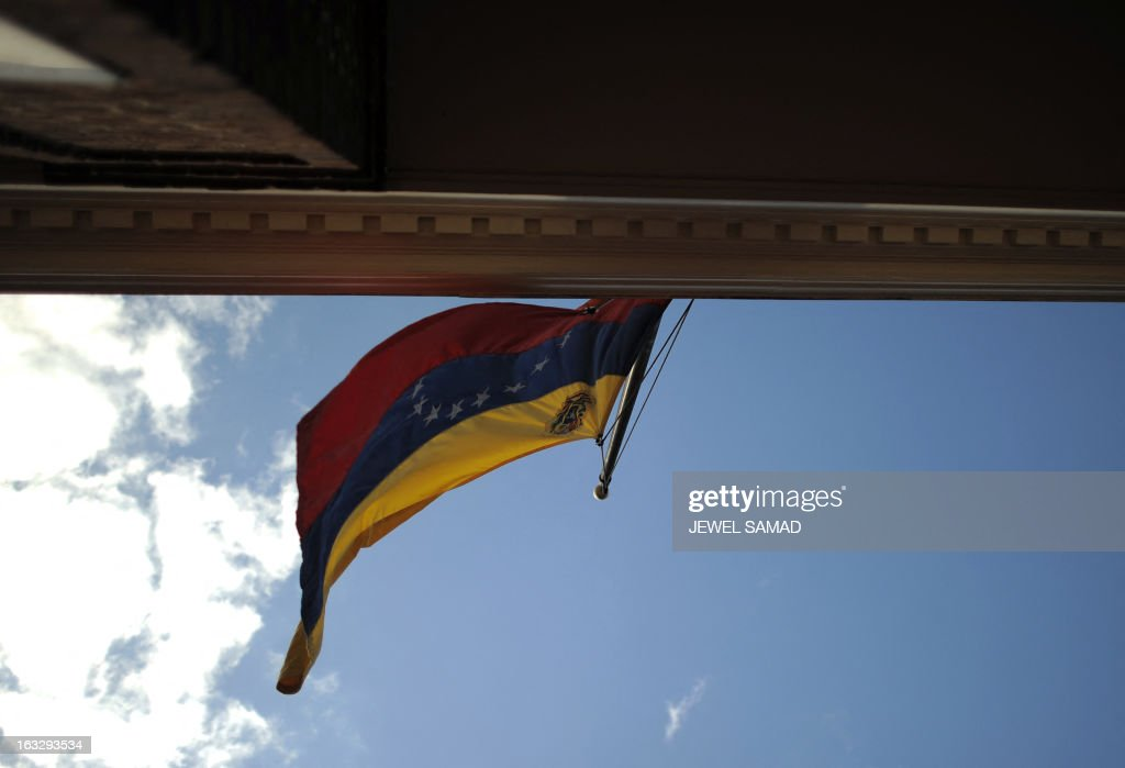 Venezuela's national flag flies half-mast to mourn the death of president Hugo Chavez at it's embassy in Washington, DC, on March 7, 2013. Condolences poured in from world leaders who had found common cause with Chavez in his 14-year campaign to galvanize the Latin American left and defy US 'imperialism.' Chavez, 58, died after a long battle with cancer, plunging Venezuela into an uncertain future after 14 years of rule by the charismatic former paratrooper, a standard-bearer of Latin America's 'anti-imperialist' left. AFP PHOTO/Jewel Samad