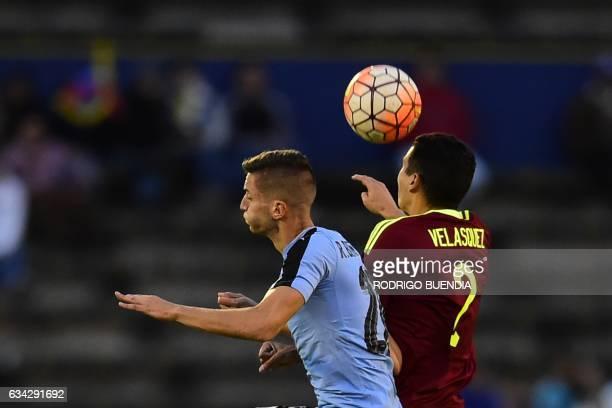 Venezuela's player William Velasquez vies for the ball with Uruguay's player Rodrigo Bentancur during their South American Championship U20 football...