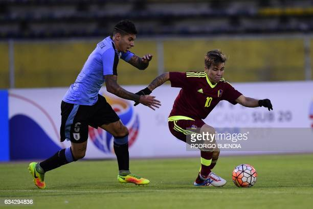 Venezuela's player Yeferson Soteldo vies for the ball with Uruguay's player Mathias Olivera during their South American Championship U20 football...