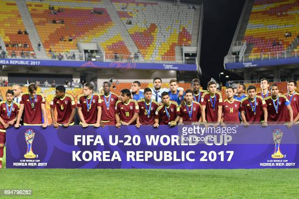 Venezuela's players attend the awards ceremony after defeat during the U20 World Cup final football match between England and Venezuela in Suwon on...