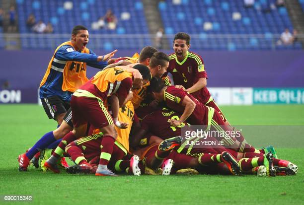 Venezuela's players celebrate a goal by Yangel Herrera during the U20 World Cup round of 16 football match between Venezuela and Japan in Daejeon on...