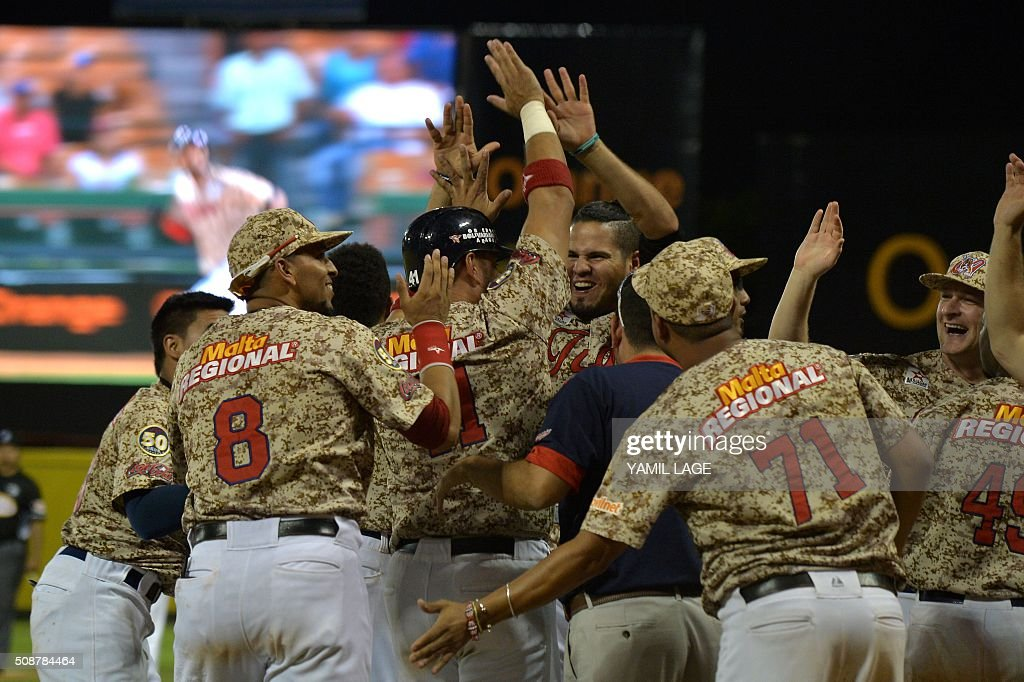 Venezuela's players celebrate after defeating Puerto Rico during their 2016 Caribbean baseball series game on February 6, 2016 in Santo Domingo, Dominican Republic. AFP PHOTO/YAMIL LAGE / AFP / YAMIL LAGE