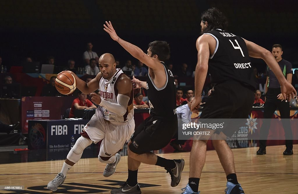 Venezuela's point guard Gregory Vargas attemps to evade the mark of Argentina's point guard Facundo Campazzo and power forward Luis Scola during a...