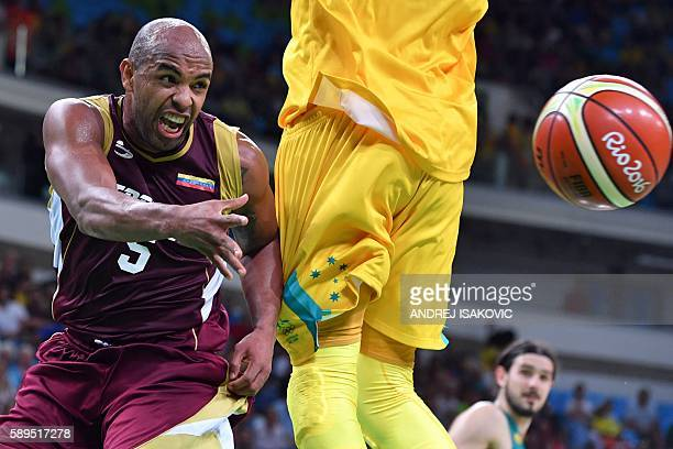 TOPSHOT Venezuela's point guard Gregory Vargas passes the ball during a Men's round Group A basketball match between Australia and Venezuela at the...