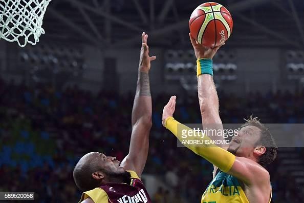 TOPSHOT Venezuela's power forward Miguel Ruiz defends against Australia's centre David Andersen during a Men's round Group A basketball match between...