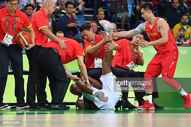 TOPSHOT Venezuela's power forward Miguel Ruiz falls below China's bench during a Men's round Group A basketball match between Venezuela and China at...