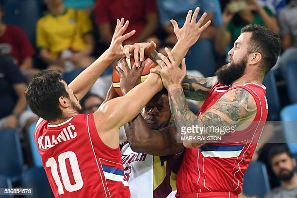TOPSHOT Venezuela's power forward Nestor Colmenares is cornered bby Serbia's forward Nikola Kalinic L0 and Serbia's centre Miroslav Raduljica during...