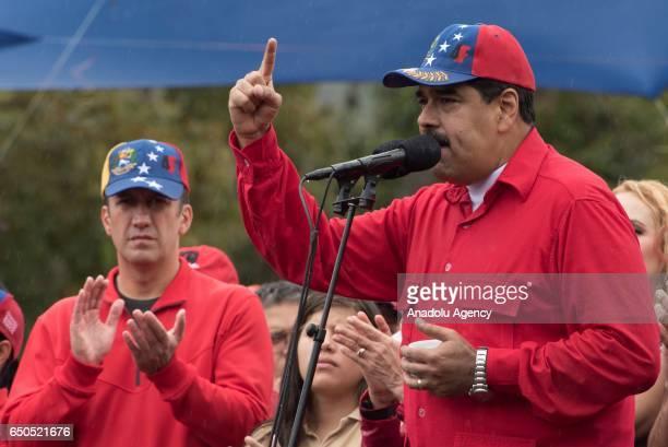 Venezuela's Presdident Nicolas Maduro and Venezuela's Vice Presdident Tareck El Aissami are seen as progovernment demonstrators hold a rally in...