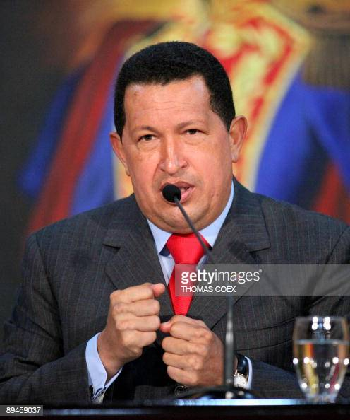 Venezuela's President Hugo Chavez gestures as he delivers a speech during a press conference at the presidential palace of Miraflores in Caracas on...