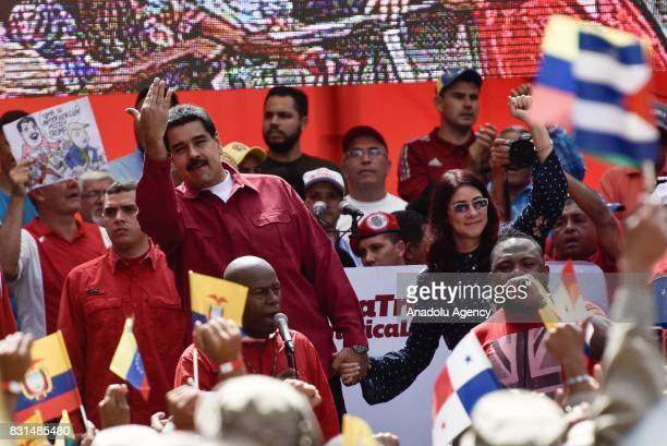 Venezuela's President Nicolas Maduro and his wife Cilia Flores attend a rally supporting Maduro and opposing US President Donald Trump in Caracas on...