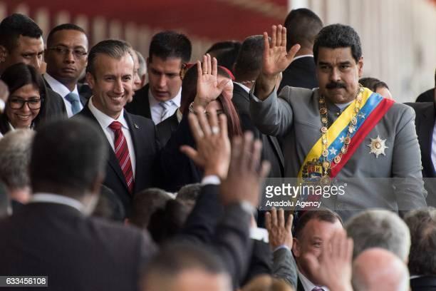 Venezuela's President Nicolas Maduro and Venezuela's Vice President Tareck El Aissami attend a military parade in Caracas Venezuela on February 1 2017