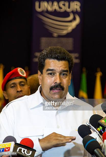 Venezuela's President Nicolas Maduro speaks to the press about the position of the UNASUR on the conflict in Syria during the VII regular meeting of...