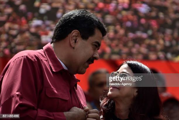 Venezuela's President Nicolas Maduro speaks with his wife Cilia Flores during a rally supporting Maduro and opposing US President Donald Trump in...