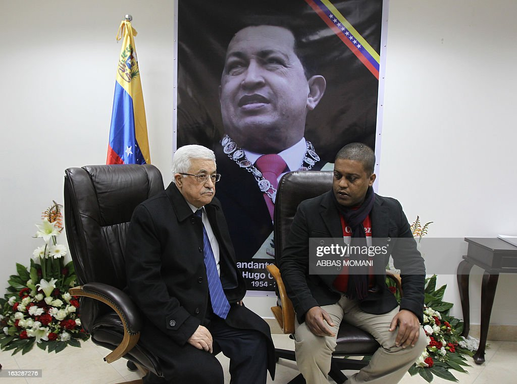 Venezuela's representative to the Palestinian Authority Luis Hernandez receives condolences from Palestinian president Mahmud Abbas for the death of late Venezuelan President Hugo Chavez at the headquarters of the Venezuelan diplomatic mission in Ramallah on March7 2013. The 58-year-old leader died on March 4, weakened by a respiratory infection after a fourth round of cancer surgery.