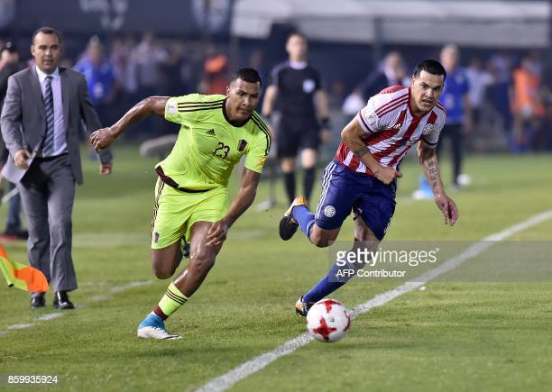 Venezuela's Salomon Rondon vie for the ball with Paraguay's Gustavo Gomez during their 2018 World Cup football qualifier match in Asuncion on October...