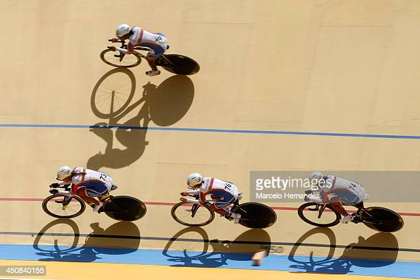 Venezuela's team Jennifer Cesar Angie Gonzalez Lilibeth Chacon and Daniely Garcia compete during the ciclyng event as part of the XVII Bolivarian...