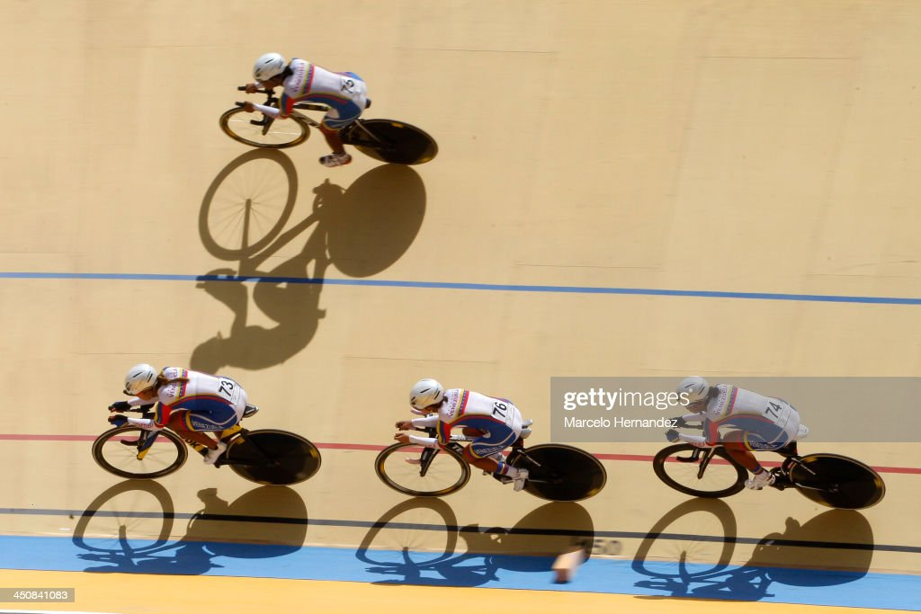 Venezuela's team Jennifer Cesar (76), Angie Gonzalez (73) Lilibeth Chacon (76) and Daniely Garcia (74) compete during the ciclyng event as part of the XVII Bolivarian Games Trujillo 2013 at Colegio San Agustin Velodrome on November 20, 2013 in Chiclayo, Peru.