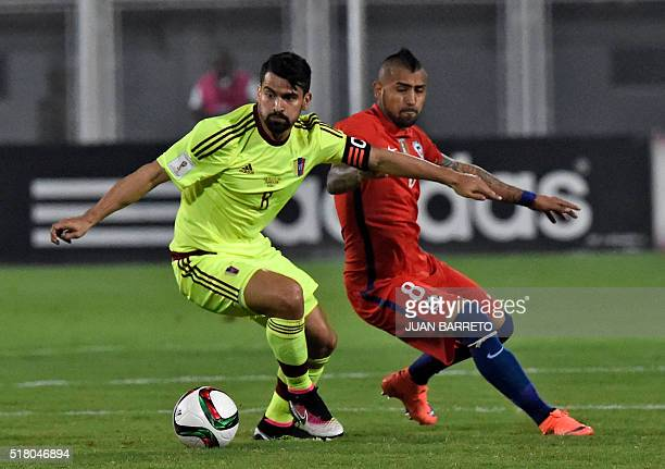 Venezuela's Tomas Rincon and Chile's Arturo Vidal vie for the ball during their Russia 2018 FIFA World Cup South American Qualifiers' football match...