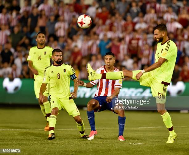 Venezuela's Tomas Rincon and Jhon Chancellor vie for the ball with Paraguay's Cecilio Dominguez during their 2018 World Cup football qualifier match...