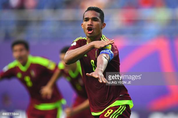 Venezuela's Yangel Herrera celebrates his goal with teammates during their U20 World Cup round of 16 football match between Venezuela and Japan in...