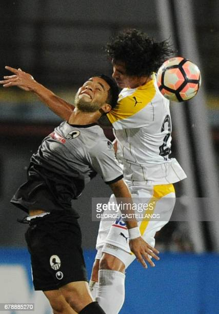 Venezuela's Zamora player Angel Faria vies for the ball with Paraguay's Guarani player Juan Aguilar during their Copa Libertadores 2017 football...
