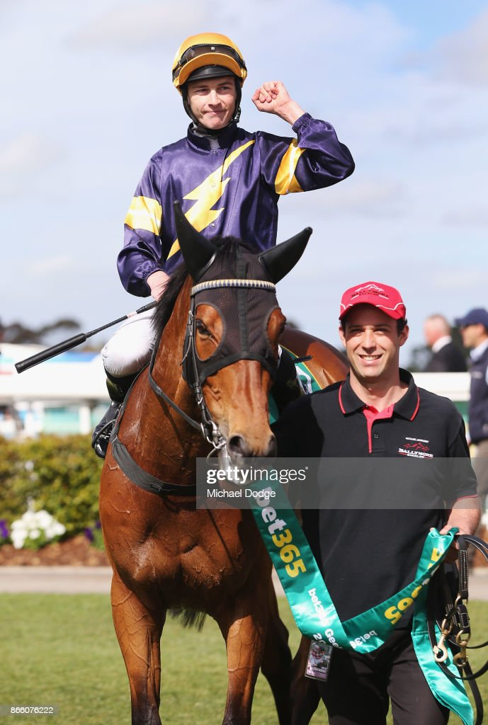 Vengeur Masque ridden by Patrick Moloney returns to scale after winning race 7 the bet365 Geelong Cup ahead of Craig Williams riding Gallic Chieftain during Melbourne Racing at Geelong Racecourse on October 25, 2017 in Melbourne, Australia.