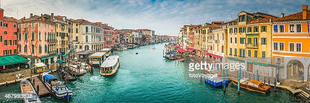 Venice boats on busy Grand Canal waterway between palazzo Italy