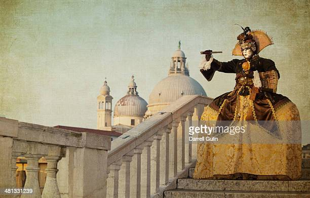 Venice Carnival with masked and costume Salute