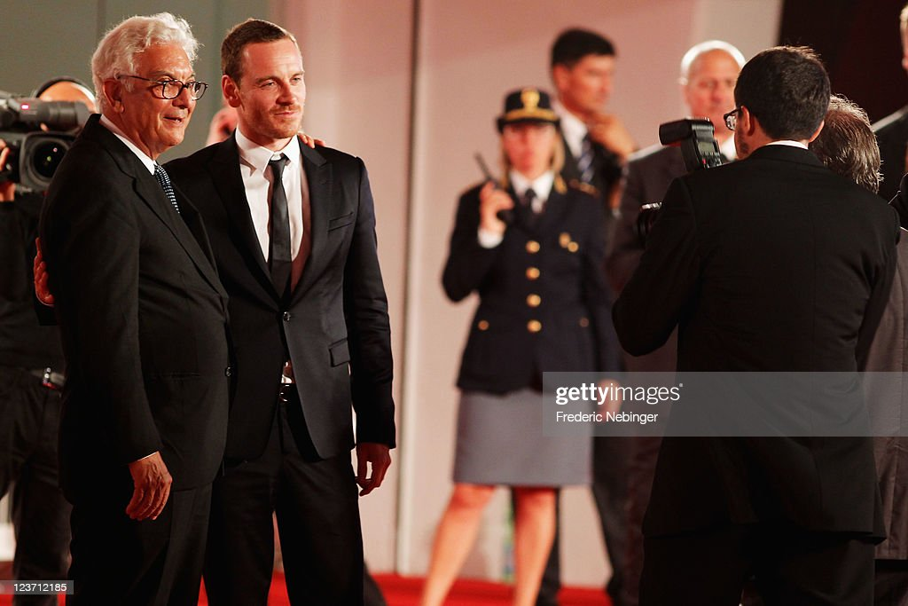 Venice Film Festival President Paolo Baratta and actor <a gi-track='captionPersonalityLinkClicked' href=/galleries/search?phrase=Michael+Fassbender&family=editorial&specificpeople=4157925 ng-click='$event.stopPropagation()'>Michael Fassbender</a> attends the 'Shame' premiere during the 68th Venice Film Festival at Palazzo del Cinema on September 4, 2011 in Venice, Italy.