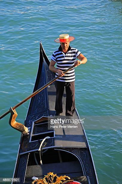 Venice, gondolier and gondola, Italy