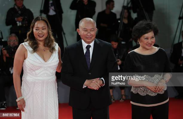 Venice Italy 08 September 2017 Annie Woo Ngau Chunlung John Woo and Angeles Woo walk the red carpet ahead of the 'Manhunt ' screening during the 74th...
