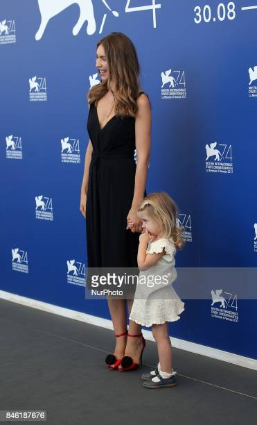 Venice Italy 08 September 2017 Christina Ferrara wife of director Abel Ferrara poses with her daughter during the 'Piazza Vittorio' photocall during...