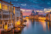 Cityscape image of Grand Canal in Venice, with Santa Maria della Salute Basilica in the background.