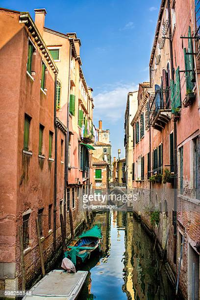 Venice with boats in day time under cloudy sky