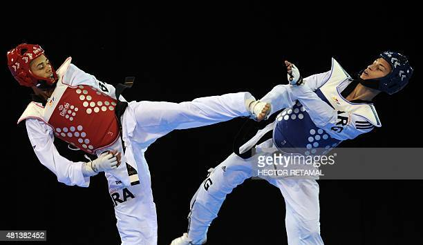 Venilton Torres of Brazil fights for the bronze medal with Lucas Guzman of Argentina in the Men's Taekwondo 58kg Final at the 2015 Pan American Games...