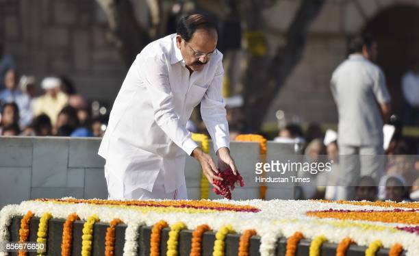 Venkaiah Naidu Vice President of India pays tribute to Mahatma Gandhi on his 148th birth anniversary at Rajghat on October 2 2017 in New Delhi India...