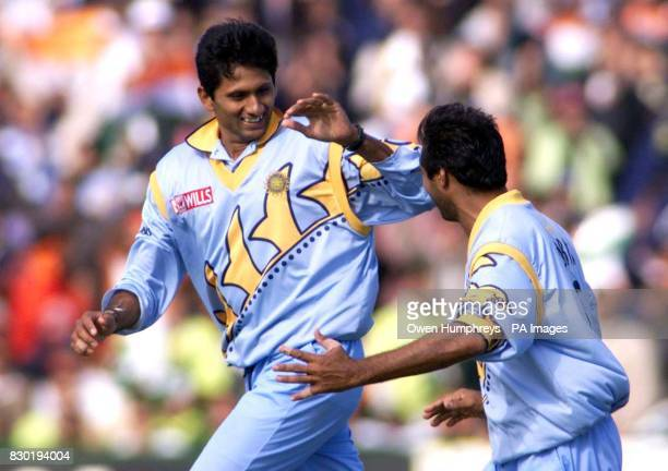 Venkatesh Prasad is congratulated by teammate Robin Singh after taking the vital wicket of Pakistani Moin Khan during their World Cup cricket Super...