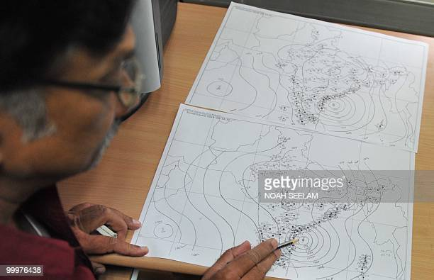 S Venkateshwar Rao assistant meteorologist from the Flood Meteorological Office shows a Surface Synoptic Chart of Cyclone Laila to journalists at the...