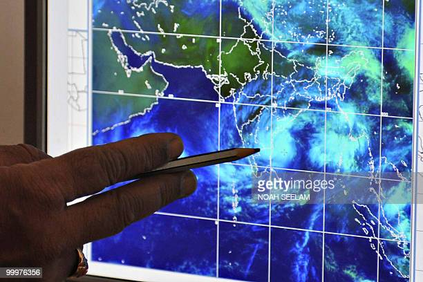 S Venkateshwar Rao assistant meteorologist from the Flood Meteorological Office points to movements of Cyclone Laila on a computer screen to...