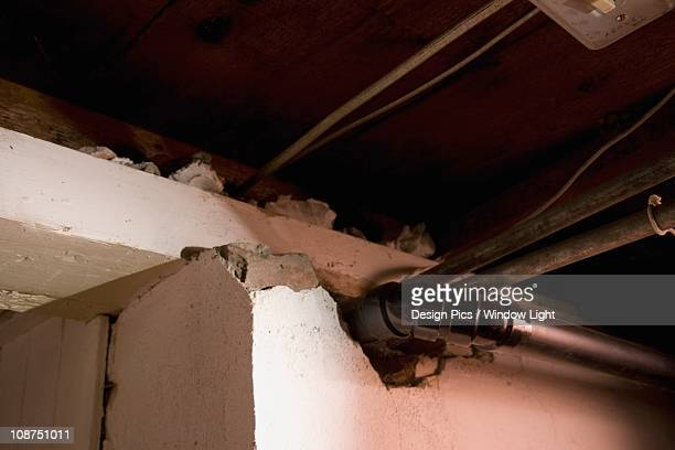 Vent And Plumbing Pipes Coming Out Of A Broken Wall