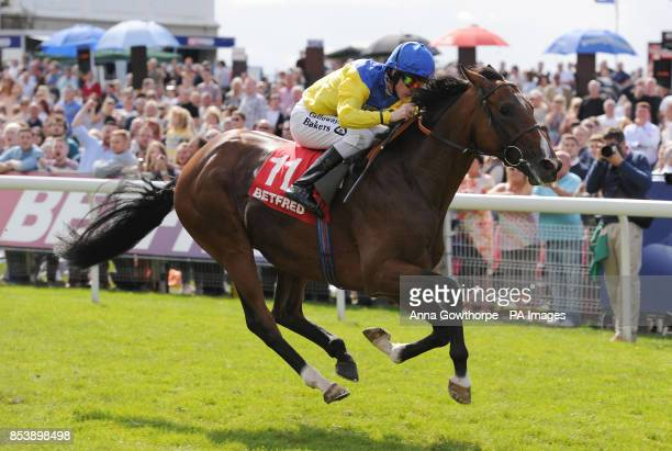 Vent de Force ridden by Richard Kingscote wins the Betfred Melrose Stakes on Betfred Ebor Day during Day Four of the 2014 Welcome To Yorkshire Ebor...