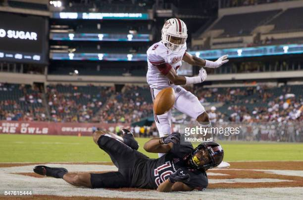 Ventell Bryant of the Temple Owls cannot make the catch against Isaiah Rodgers of the Massachusetts Minutemen in the second quarter at Lincoln...