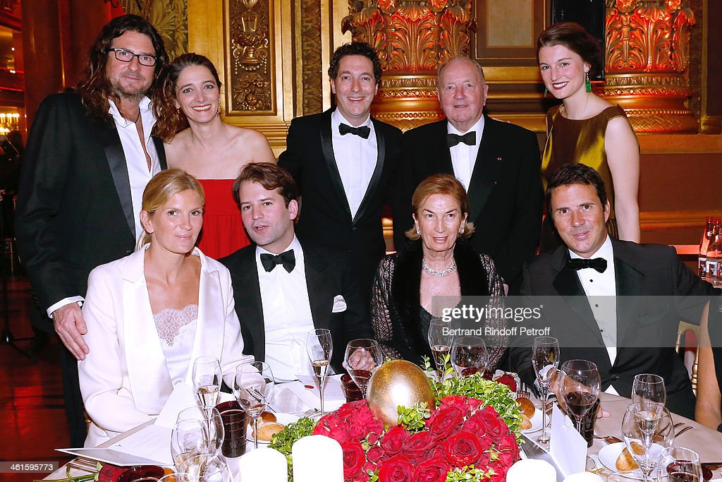 CEO Ventes Privees Jacques-Antoine Granjon, Actor Guillaume Gallienne with his wife Amandine Gallienne, Baron <a gi-track='captionPersonalityLinkClicked' href=/galleries/search?phrase=Albert+Frere&family=editorial&specificpeople=606642 ng-click='$event.stopPropagation()'>Albert Frere</a>, Baroness <a gi-track='captionPersonalityLinkClicked' href=/galleries/search?phrase=Albert+Frere&family=editorial&specificpeople=606642 ng-click='$event.stopPropagation()'>Albert Frere</a> (1st row 2nd R), their daughter Segolene Gallienne (1st row 1st L) with her husband Ian Gallienne (1st row 1st R) and grandson of Baron <a gi-track='captionPersonalityLinkClicked' href=/galleries/search?phrase=Albert+Frere&family=editorial&specificpeople=606642 ng-click='$event.stopPropagation()'>Albert Frere</a> (1st row 2nd R) attend Arop Charity Gala with 'Ballet du Theatre Bolchoi'. Held at Opera Garnier on January 9, 2014 in Paris, France.