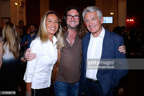 Ventes Privees JacquesAntoine Granjon standing between Producers Nicole and Gilbert Coullier attend the 'Open Space' Theater Play at Theatre de Paris...