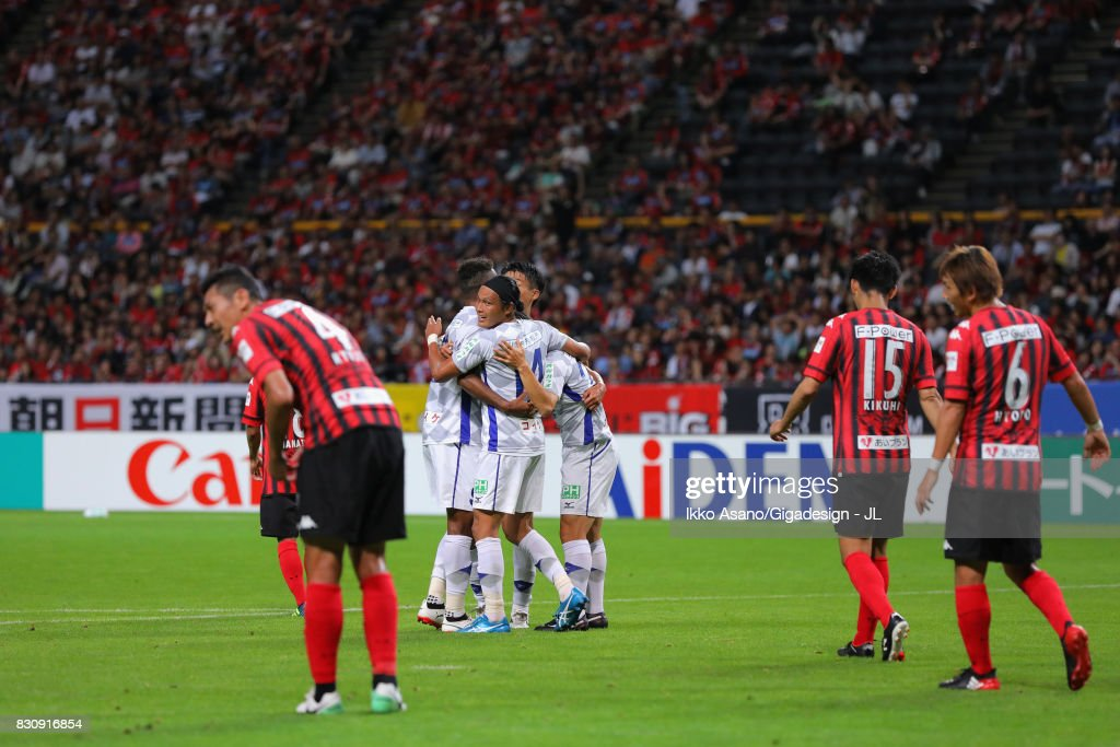 Ventforet Kofu players celebrate their side's first goal during the J.League J1 match between Consadole Sapporo and Ventforet Kofu at Sapporo Dome on August 13, 2017 in Sapporo, Hokkaido, Japan.