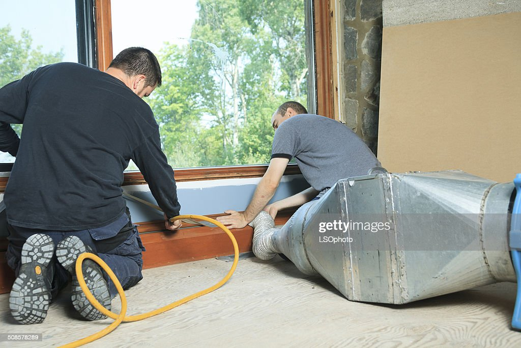 Ventilation Cleaner - Two Employee : Stock Photo